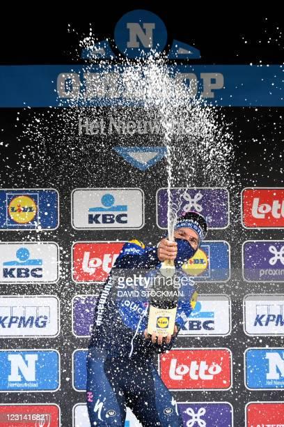 Team Deceuninck - Quick-Step Italian rider Davide Ballerini celebrates on the podium after winning the World Tour 2021 Omloop Het Nieuwsblad one day...
