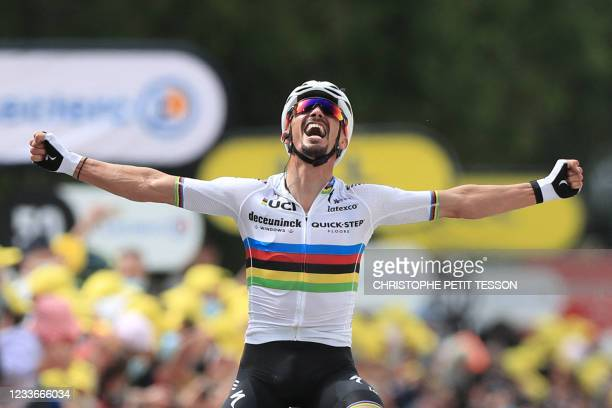 Team Deceuninck Quickstep's Julian Alaphilippe of France celebrates as he crosses the finish line to win the 1st stage of the 108th edition of the...