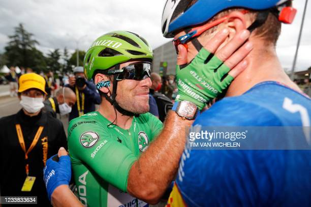 Team Deceuninck Quickstep's Mark Cavendish of Great Britain wearing the best sprinter's green jersey celebrates after winning the 10th stage of the...