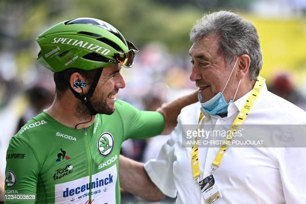 Team Deceuninck Quickstep's Mark Cavendish of Great Britain wearing the best sprinter's green jersey poses for a photograph with Belgian cycling...