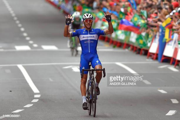 Team Deceuninck rider Belgium's Philippe Gilbert crosses the finish line of the twelfth stage of the 2019 La Vuelta cycling Tour of Spain, a 171,4 km...