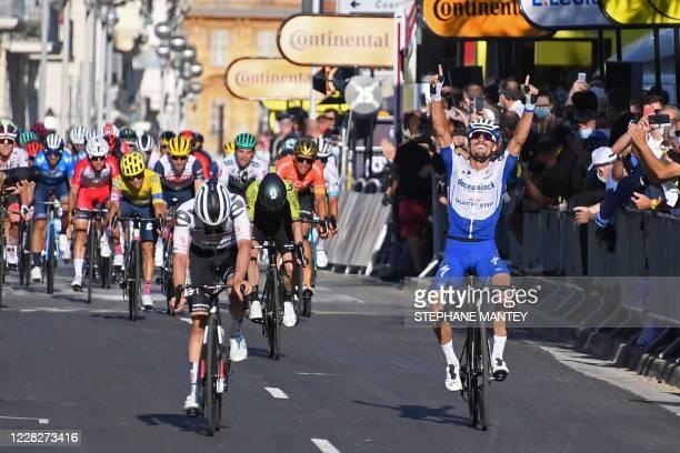 Team Deceuninck rider France's Julian Alaphilippe celebrates after crossing the finish line ahead of Team Sunweb rider Switzerland's Marc Hirschi...