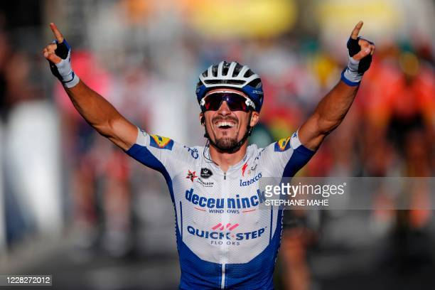 Team Deceuninck rider France's Julian Alaphilippe celebrates as he crosses the finish line to win the 2nd stage of the 107th edition of the Tour de...