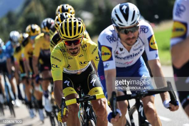 Team Deceuninck rider France's Julian Alaphilippe wearing the overall leader's yellow jersey rides in the pack during the 4th stage of the 107th...