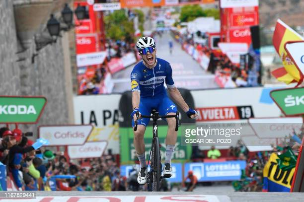 Team Deceuninck rider France's Remi Cavagna celebrates as he crosses the finish line of the 19th stage of the 2019 La Vuelta cycling Tour of Spain a...