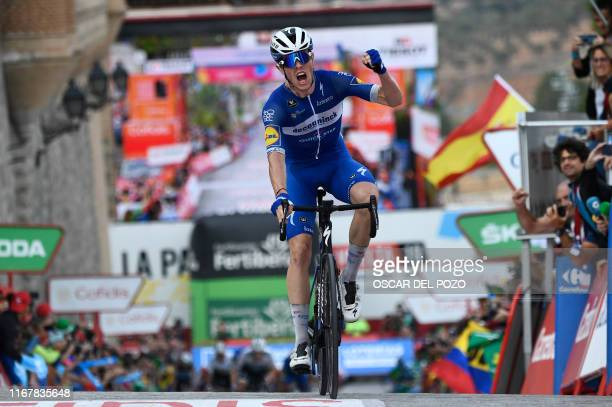 TOPSHOT Team Deceuninck rider France's Remi Cavagna celebrates as he crosses the finish line of the 19th stage of the 2019 La Vuelta cycling Tour of...