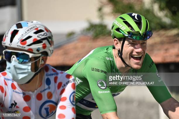 Team Deceuninck rider Ireland's Sam Bennett wearing the best sprinter's green jersey and Team AG2R La Mondiale rider France's Benoit Cosnefroy...