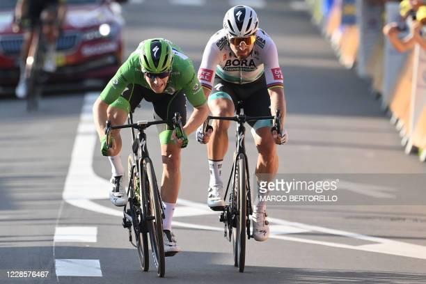 Team Deceuninck rider Ireland's Sam Bennett wearing the best sprinter's green jersey and Team Bora rider Slovakia's Peter Sagan cross the finish line...