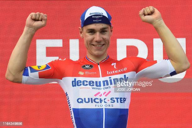 Team Deceuninck rider Netherlands' Fabio Jakobsen celebrates on the podium after winning the fourth stage of the 2019 La Vuelta cycling tour of...