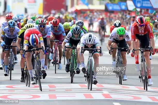 Team Deceuninck rider Netherlands' Fabio Jakobsen , Team Bora rider Ireland's Sam Bennett and Team Sunweb rider Germany's Max Walscheid cross the...