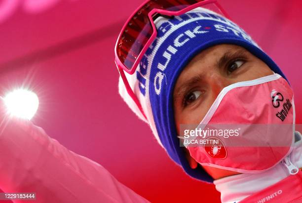 Team Deceuninck rider Portugal's Joao Almeida celebrates his overall leader pink jersey on the podium after the 16th stage of the Giro d'Italia 2020...
