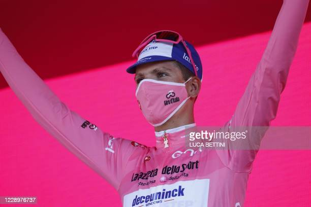 Team Deceuninck rider Portugal's Joao Almeida celebrates on the podium after receiving the pink jersey in the seventh stage of the Giro d'Italia 2020...