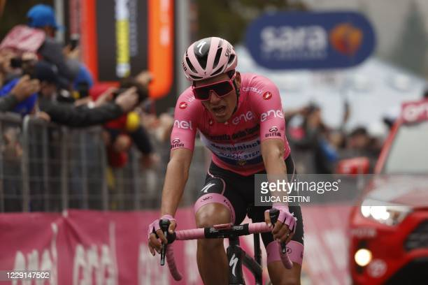 Team Deceuninck rider Portugal's Joao Almeida crosses the finish line at the end of the fifteenth stage of the Giro d'Italia 2020 cycling race, a...