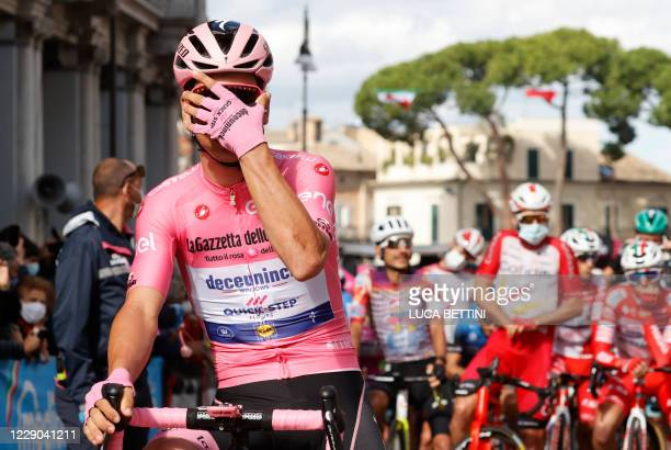 Team Deceuninck rider Portugal's Joao Almeida wearing the leader's pink jersey adjust the sunglasses prior the start of the 10th stage of the Giro...