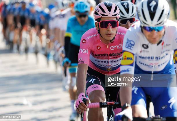 Team Deceuninck rider Portugal's Joao Almeida wearing the overall pink jersey rides during the 11th stage of the Giro d'Italia 2020 cycling race, a...