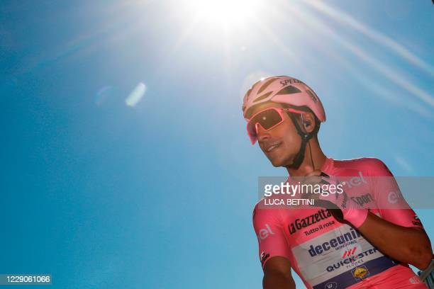 Team Deceuninck rider Portugal's Joao Almeida wearing the pink jersey looks on prior the 11th stage of the Giro d'Italia 2020 cycling race, a...