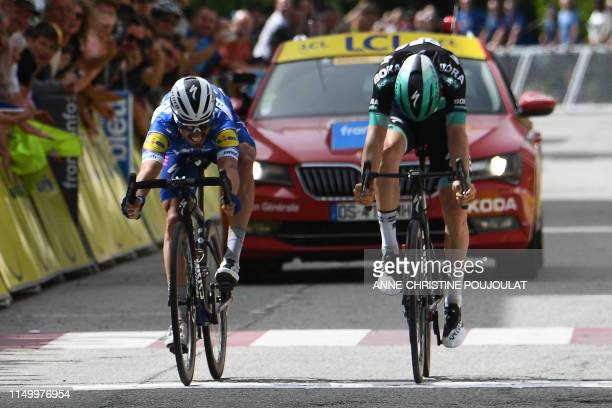 Team DeceuninckQuickStep rider France's Julian Alaphilippe reacts as he crosses first the finish line past BoraHansgrohe rider Austria's Gregor...