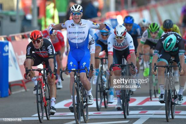 Team Deceuninck's Irish rider Sam Bennett celebrates as he crosses the finish-line before being relegated during the 9th stage of the 2020 La Vuelta...