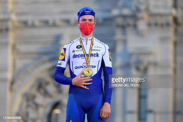 Team Deceuninck's Irish rider Sam Bennett poses on the podium after the 18th and final stage of the 2020 La Vuelta cycling tour of Spain, a 124,2-km...
