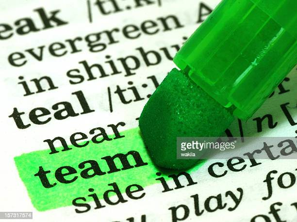 team definition word highlighted in dictionary - community engagement stock pictures, royalty-free photos & images