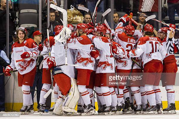 Team Denmark celebrates their first ever IIHF World Junior win over Switzerland on December 30, 2014 at the Air Canada Centre in Toronto, Ontario,...
