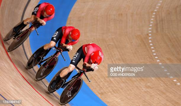 Team Denmark competes in the men's track cycling team pursuit qualifying event during the Tokyo 2020 Olympic Games at Izu Velodrome in Izu, Japan, on...