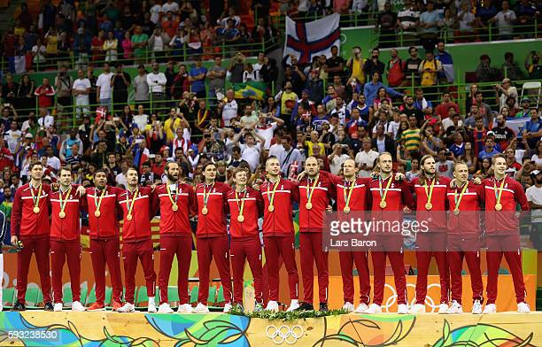 Team Denmark pose on the podium during the medal ceremony for Men's Handball after winning the gold medal on Day 16 of the Rio 2016 Olympic Games at...