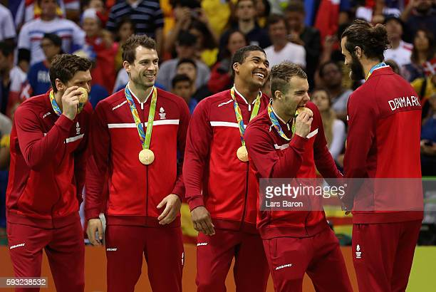 Team Denmark react during the medal ceremony for Men's Handball after winning the gold medal on Day 16 of the Rio 2016 Olympic Games at Future Arena...