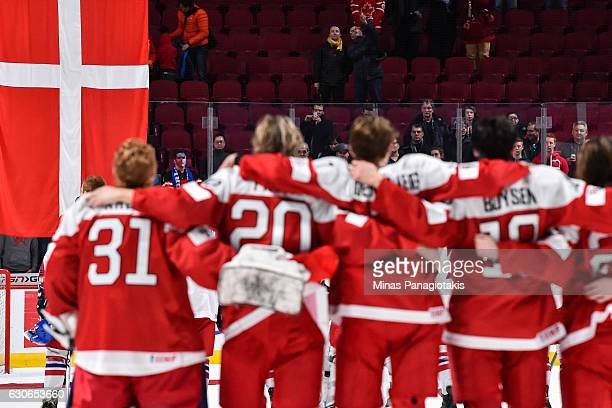 Team Denmark watch as their country's flag is raised during the 2017 IIHF World Junior Championship preliminary round game against Team Czech...