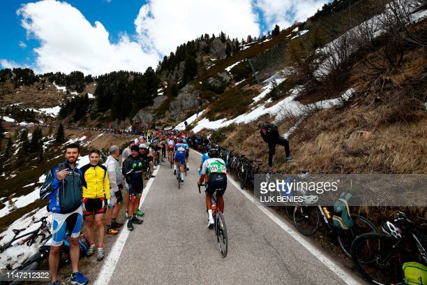 Team Dimension Data rider Eritrea's Amanuel Ghebreigzabhier takes the ascent of the Manghen pass during stage twenty of the 102nd Giro d'Italia Tour...