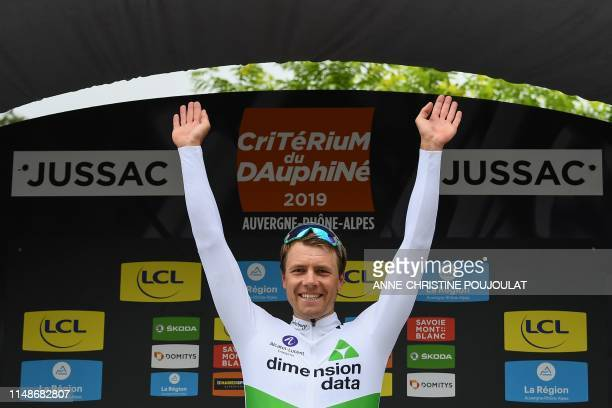 Team Dimension Data rider Norway's Edvald Boasson Hagen celebrates on the podium after winning the first stage of the 71st edition of the Criterium...