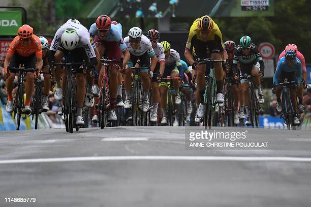 Team Dimension Data rider Norway's Edvald Boasson Hagen sprints with Team Katusha Alpecin rider Germany's Nils Politt and Team JumboVismarider...