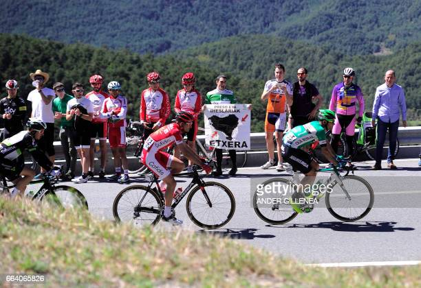 Team Dimension Data's Igor Anton team Cofidis' Yoann Bagot and team Caja Rural's Luis Guille Mas climb the Erro hill near Pamplona on April 3 2017...
