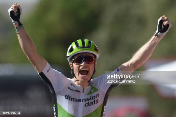 Team Dimension Data's US cyclist Benjamin King celebrates as he crosses the finish line winning the fourth stage of the 73rd edition of La Vuelta...