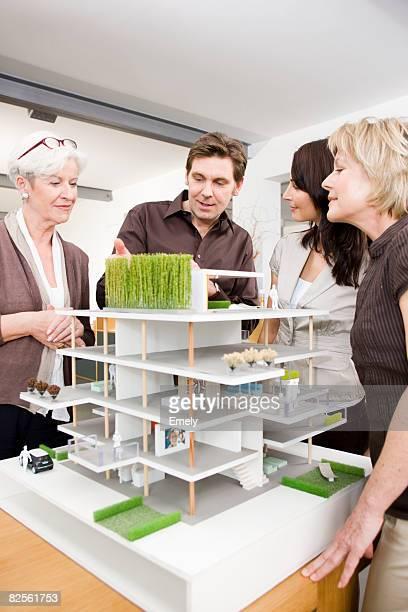 Team discussing architecture model