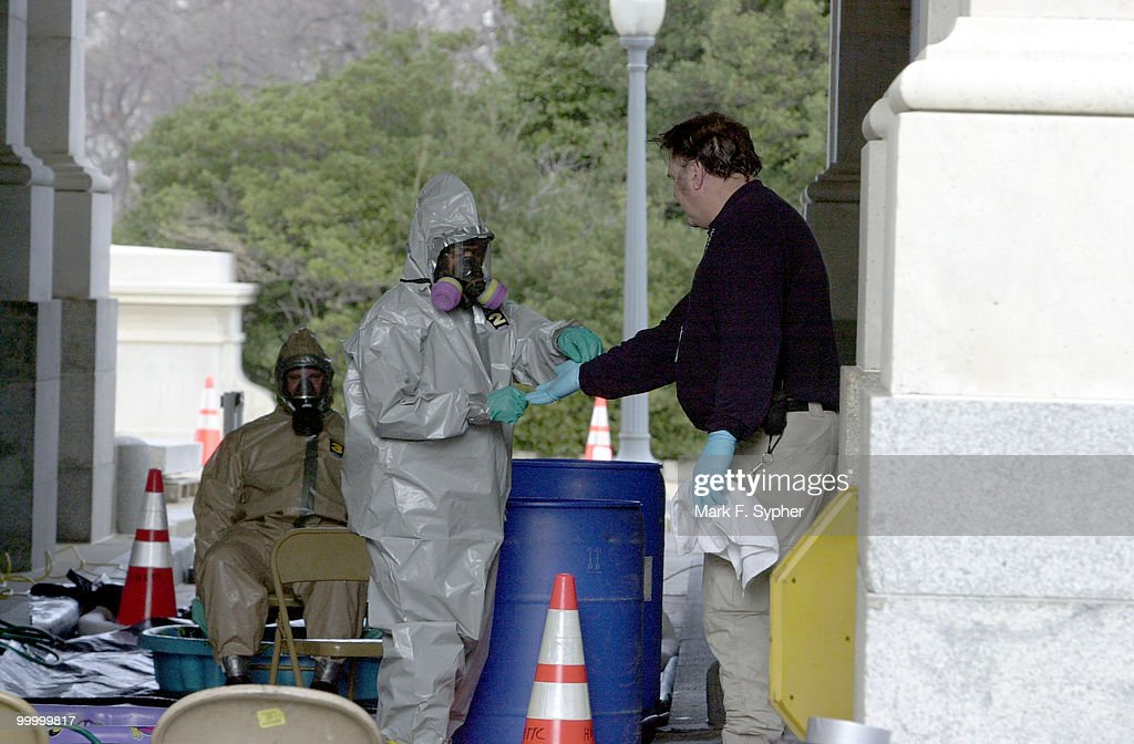 A HAZMAT team disrobes after decontaminating themselves on Thursday outside of the U.S. Capitol.