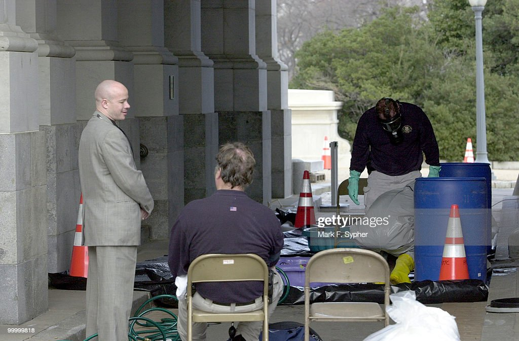 A HAZMAT team disrobes after decontaminating themselves on Thursday outside of the U.S. Capitol. A second letter addressed to Senate Majority Leader Tomas Daschle was suspected to have contained anthrax.