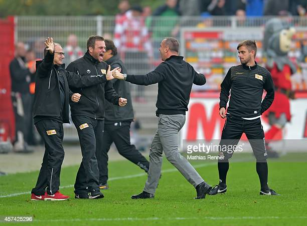 Team doctor Dr. Tankred Haase, physiotherapist / Reha-coach Hendrik Schreiber and coach Norbert Duewel of 1 FC Union Berlin celebrate after scoring...