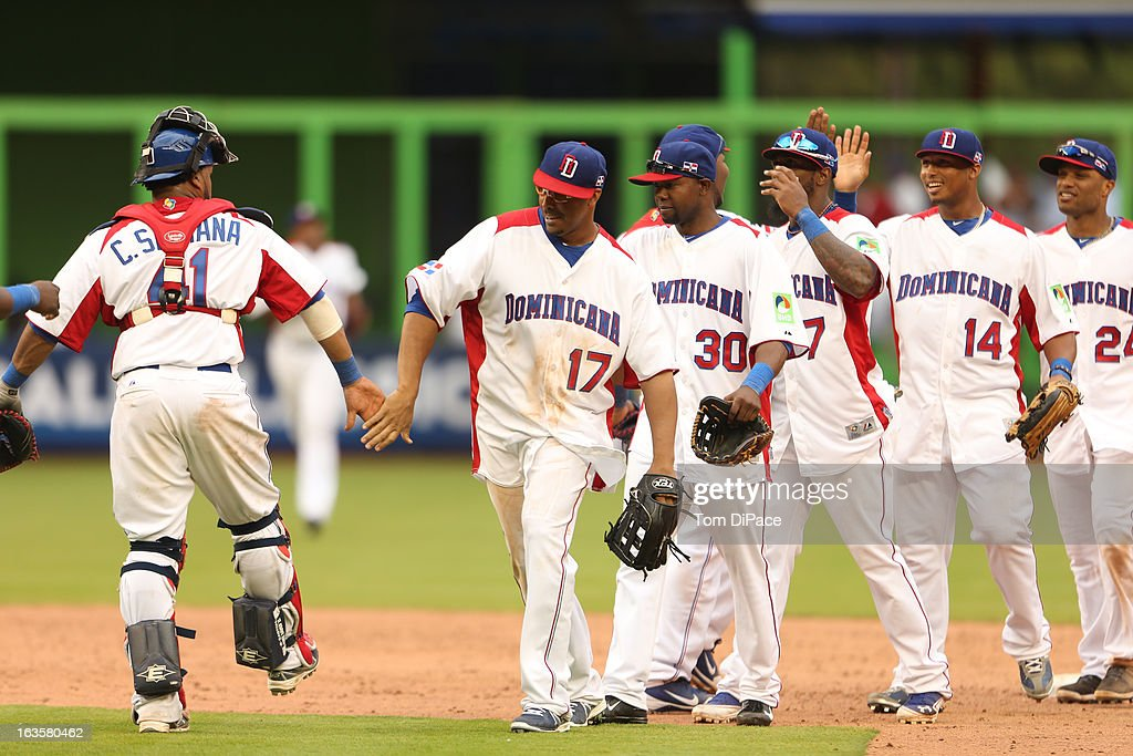 Team Dominican Republic celebrates after defeating Team Italy during Pool 2, Game 1 in the second round of the 2013 World Baseball Classic on Tuesday, March 12, 2013 at Marlins Park in Miami, Florida.
