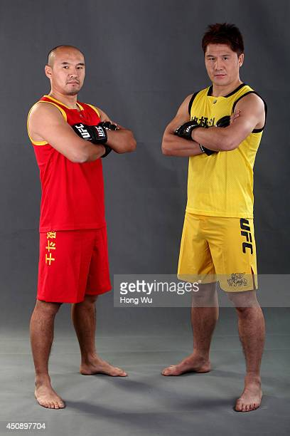 Team Dragon coach Zhang Tiequan and Team Lion coach Ao Hailin pose for a portrait on media day at the TUF Gym during filming of the TUF China...
