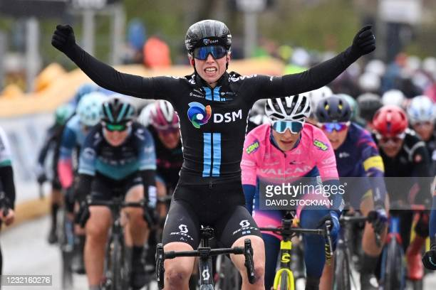 Team DSM Dutch Lorena Wiebes celebrates and wins as she crosses the finish line, in Schoten, of the first edition of the one day Women cycling race...