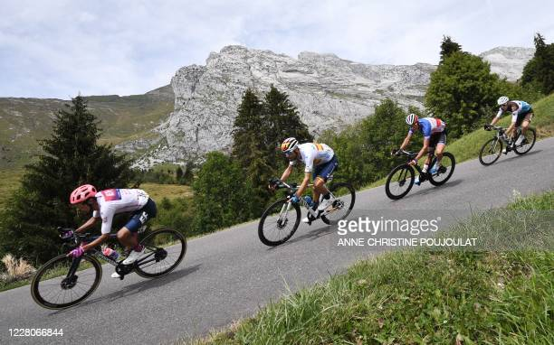 Team Education First rider Colombia's Daniel Martinez rides on the downhill followed by Team Movistar rider Spain's Alejandro Valverde during the...