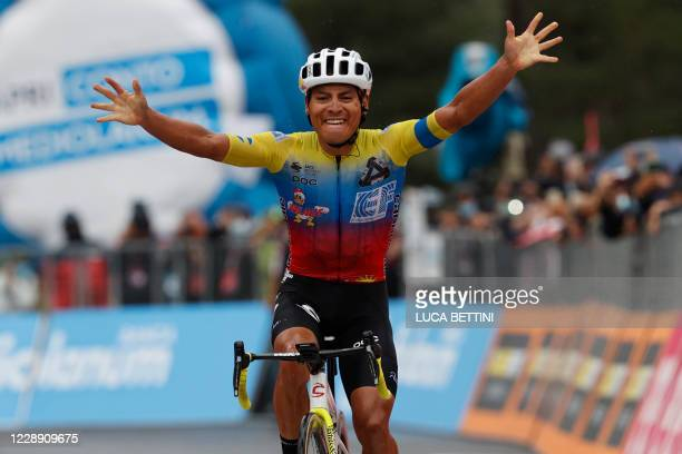 Team Education First rider Ecuador's Jonathan Caicedo celebrates as he crosses the finish line to win on October 5, 2020 the 3rd stage of the Giro...