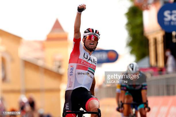 Team Emirates Italian rider Diego Ulissi celebrates as he crosses the finish line of the second stage of the 2020 Giro d'Italia, a 149 km route...