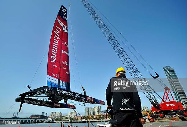 Team Emirates launches their AC72 Racing Yacht into the San Francisco Bay for an America's Cup training session in San Francisco on July 2 2013...