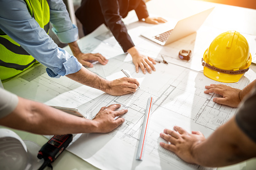 Team Engineer drawing graphic planning 1001996836