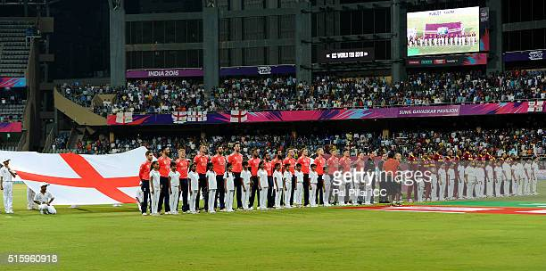 Team England and Team West Indies stand for the national anthem before the start of the ICC World Twenty20 India 2016 match between West Indies and...