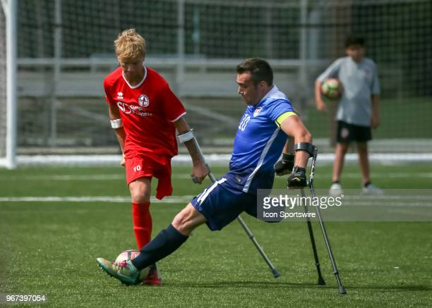 Team England Jamie Tregaskiss and Team USA Nico Calabria fight for ball during the Lone Star Invitational Amputee Soccer tournament on June 2 2018 at...