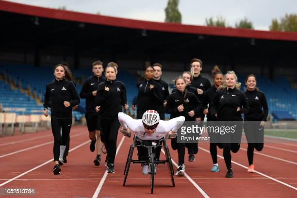 Team England para athletics star from the Gold Coast 2018 Commonwealth Games Nathan Maguire with members of Birchfield Harriers at the Alexander...