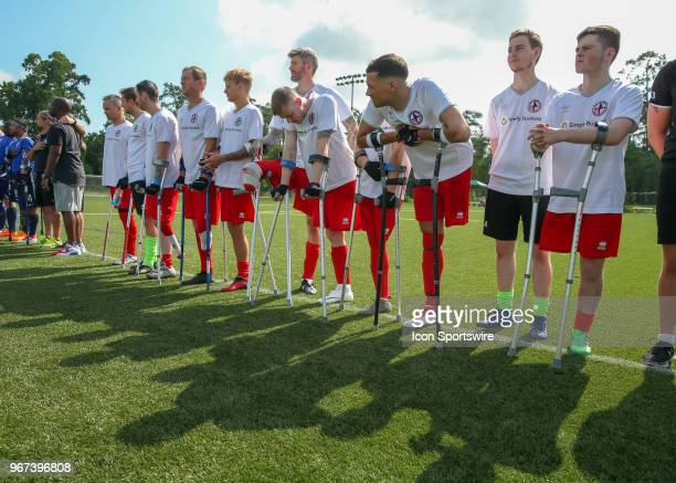 Team England players listen to remarks for the opening ceremony during the Lone Star Invitational Amputee Soccer tournament on June 2 2018 at Gosling...